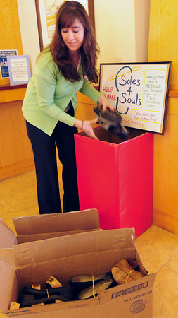 Newbury: Courtney Lopes at the Newburyport Bank branch in Newbury is collecting shoes which are going to Japan. Bryan Eaton/Staff Photo