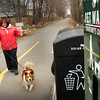 Newburyport: Joann Goldsmith of Amesbury walks her dogs Louis, left, and Cassie along the Clipper City Rail Trail near Washington Street in Newburyport. Owner of a pet-sitting business Pet au Pair, she buys dog waste disposal bags by the case. Bryan Eaton/Staff Photo