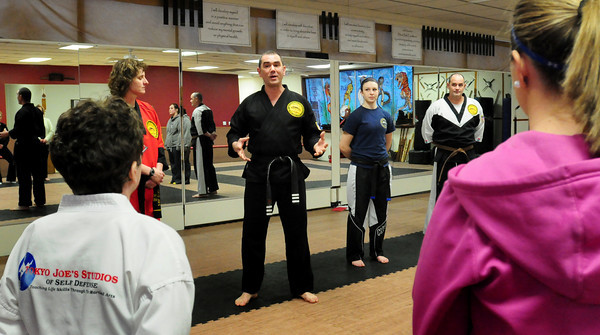 Salisbury: Kendall Buhl meets with a group of women before the start of thier self-defense class at Tokyo Joe's Studio in Salisbury. Bryan Eaton/Staff Photo