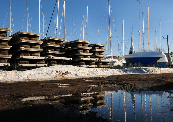 Newburyport: Sailboat masts and docks at the Windward Yacht Yard reflect in a puddle, a reminder that spring is coming in 16 days. More melting of snow is expected this weekend with temperatures likely getting into the 50's on Sunday. Bryan Eaton/Staff Photo