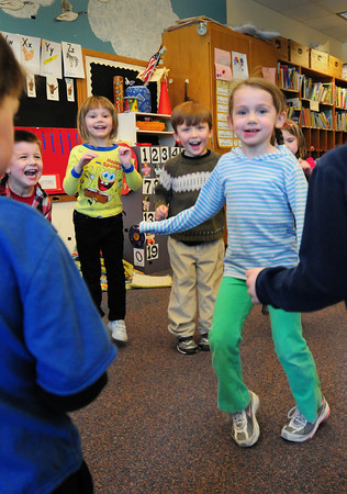 """Newbury: Preschoolers dance to a Spanish version of """"Volare"""" in Mary Jo Lagana's class at Newbury Elementary School on Thursday afternoon. The children danced to several Latin tunes to get them ready for """"clean up"""" at the end of the day. Bryan Eaton/Staff Photo"""