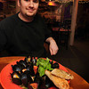 Chef Josh Marshall of David's with P.E.I. mussels steamed in white wine and garlic with tomato and fresh basil, served with garlic toast, one of three appetizer options for Restaurant Week. Bryan Eaton/Staff Photo