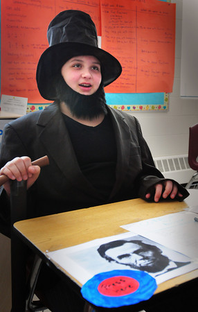 Seabrook: Abraham Lincoln a.k.a. Mackenzie Hardy, 11, gives a brief discription of the 16th president of the United States to visitors at a living Wax Museum at Seabrook Middle School on Friday afternoon. The students researched different characters from history and researched their life for a presentation to parents and friends. Bryan Eaton/Staff Photo