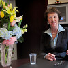 Newburyport: With congratulatory flowers about her newly painted office, Janice C. Morse talks about her new role at the Newburyport Bank. Bryan Eaton/Staff Photo