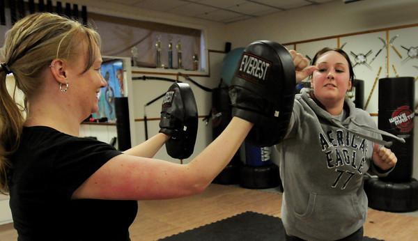 Salisbury: Alicia Belanger, right, practices defensive moves on friend Jen Beliveau. Bryan Eaton/Staff Photo