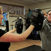 Salisbury: Alicia Belanger, right, practices defensive moves on friend Jen Beliveau. Bryan Eaton/Staff Photo