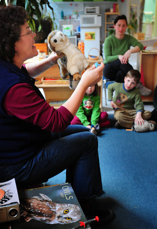 Newburyport: Lisa Hutchings from Audubon Society Joppa Flats Education Center shows owls use their talons to catch their pray. She was presenting the program on owls and raptors at the Newburyport Montessori School on Wednesday afternoon. Bryan Eaton/Staff Photo