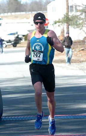 Salisbury: Dan Vasello of Reading crosses first in the April Fool's Day Race. Bryan Eaton/Staff Photo