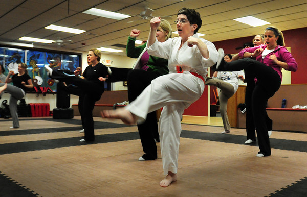 Salisbury: Women practice kicking technique. Bryan Eaton/Staff Photo