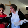 Newburyport: Salvation Army Major Kathy Purvis rehearses some songs with SImone Lloyd, 11, in music mentoring at the Newburyport chapter. They're getting ready for an upcoming competition within the Salvation Army. Bryan Eaton/Staff Photo
