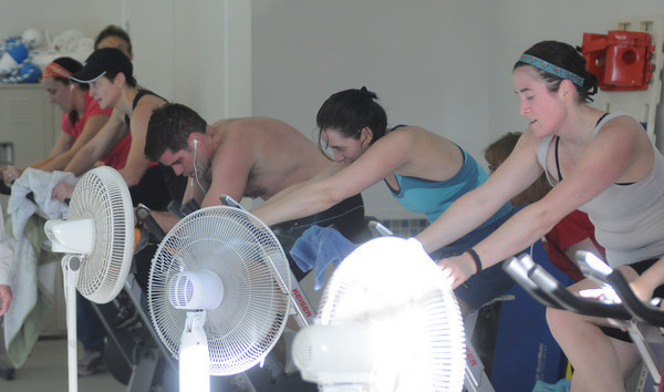 Newburyport: Electric fans cool of bikers in the 2nd Annual Indoor Triathlon at the YWCA in Newburyport Sunday morning.The event consisted of a 10 min swim , a 25 mins on a stationary =bike and a 1.5 mile run on the rail trail. Jim Vaiknoras/Staff photo