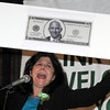 "Newburyport: Newburyport Mayor Donna Holaday holds up ""Costello Cash"" at the 9th St Patrick's Day Luncheon at the Masonic Temple in Newburyport. JIm Vaiknoras/Staff photo"