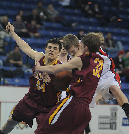 lowell: Newburyport's Eric Meyer #44 and Zach Fenton collide with Watertown's Tyler Romanelli  during their North Sectional Championship at the Tsongas Center in Lowell Saturday night. Jim Vaiknoras/Staff photo
