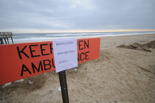 Salisbury: One of many signs along local beaches, this one in Salisbury, closing the beaches do to small waste water treatment filters that washed down the Merrimack River from New Hampshire.JIm Vaiknoras/Staff photo