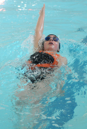 Newburyport: Rachel Ameen, 12, does the back stroke during the 2nd Annual Indoor Triathlon at the YWCA in Newburyport Sunday morning.The event consisted of a 10 min swim , a 25 mins on a stationary =bike and a 1.5 mile run on the rail trail. Jim Vaiknoras/Staff photo