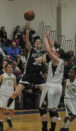 Wilmington Pentucket's Tess Nogueira glides in for two  aqainst  St Mary's at Wilmington high Wednesday night. Jim Vaiknoras/staff photo