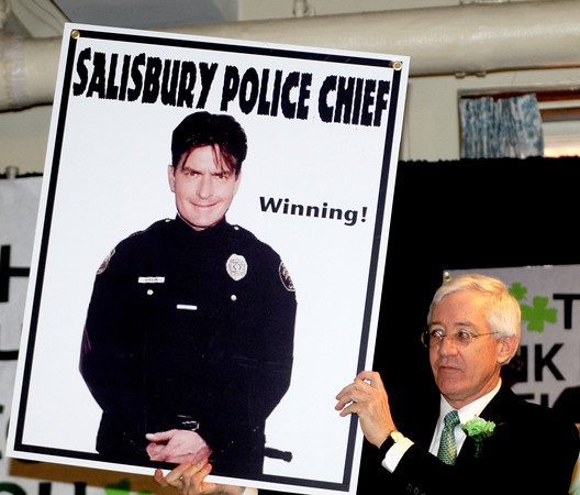 Newburyport: Charlie Cullen holds up a photo of actor Charlie Sheen as the new Salisbury police chief at the 9th St Patrick's Day Luncheon at the Masonic Temple in Newburyport. JIm Vaiknoras/Staff photo