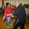 Amesbury: Kyoshi Herman Ocasio of Ocasio's Martial Arts in Plaistow, N.H awards a white belt to Kathy T. at Coastal Connections in Amesbury, Kathy was one of about 15 people to earn their white belts in karate. Jim Vaiknoras/Staff photo