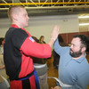 Amesbury: Chris Daigle, who is an instructor at Ocasio's Martial Arts in Plaistow, N.H, high fives Jay C. after he recieved his white belt in karate at Coastal Connections in Amesbury. Jim Vaiknoras/Staff photo