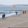 Newbury: People stroll Plum Island Sunday afternoon , enjoying the warm weather. Jim Vaiknoras/Staff photo