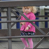 Amesbury: Asha Kerrin, 2, carrys a red ballon as she crosses the Millyard bridge over the Powow River in Amesbury. Asha, who lives in Ipswich, was in Amesbury with her parents to celebrate her dad Matthews birthday. Jim vaiknoras/Staff photo
