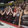 "lowell: Newburyport fans shout ""Yeat"" during team introduction at the North Sectional Championship at the Tsongas Center in Lowell Saturday night aqainst Watertown. Despite the support the Clipper were defeated 55-31. Jim Vaiknoras/Staff photo"