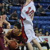 lowell: Newburyport's Drew Carter up fakes Watertowns Marco Coppola during their 55-31 loss to Watertown in the North Sectional Championship at the Tsongas Center in Lowell Saturday night. Jim Vaiknoras/Staff photo