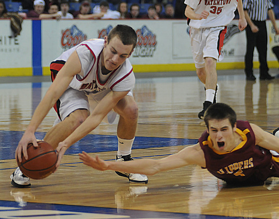 lowell:Watertown's Danny Kelly gets to a loose ball just ahead of a  out streached arm of a diving Chris Jayne of Newburyport during their North Sectional Championship at the Tsongas Center in Lowell Saturday night. Jim Vaiknoras/Staff photo