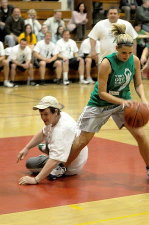 newburyport: Parent Dan LaValley and teacher Jessica Delacey scrabble for a loose ball at the 3rd Annual Parent/Teacher Basketball game at the Nock Middle thursday night. Jim Vaiknoras/staff photo
