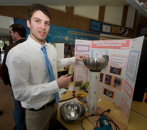 Newburyport: Noah Jordan explains his Van De Graaff's generator  as part of his project at the Newburyport High School Science Fair at the school Sunday. JIm Vaiknoras/Staff photo