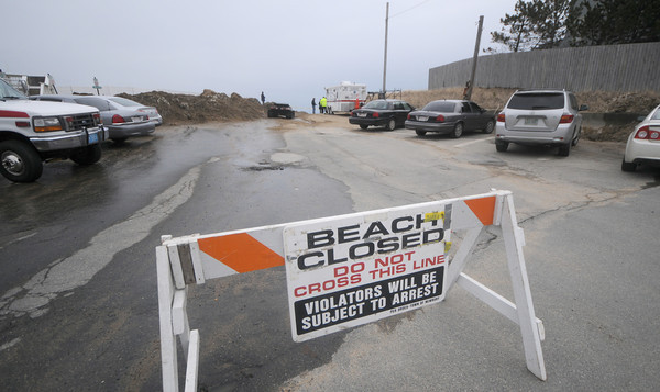 Newbury: A sign blocking entrance to the parking lot at Plum Island Center closing the beach due to small plastic waste water treatment filter that have washed down the Merrimack River from New Hampshire. Jim Vaiknoras/Staff photo