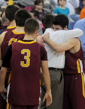lowell: Newburyport senior captain Will Habib hugs his coach Tom L'Italien after the teams 55-31 loss to Watertown in the North Sectional Championship at the Tsongas Center in Lowell Saturday night. Jim Vaiknoras/Staff photo