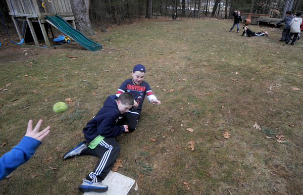Rowley: Hayden and Dylan Marshall of Rowley are safe as the slide during a game of pickle at a birthday party in Rowley. Jim Vaiknoras/Staff photo