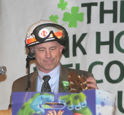 Newburyport: Amesbury Mayor Thatcher Kezer shows off some Newburyport presents for visiting mayors, including hazmat gear and dog waste removal gear at the 9th St Patrick's Day Luncheon at the Masonic Temple in Newburyport. JIm Vaiknoras/Staff photo