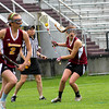 Newburyport: Newburyport freshman Julia Kipp, with ball, leads the Clippers lacrosse team in scoring this season. Photo by Ben Laing/Staff Photo