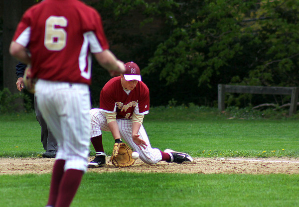 Newburyport: Clippers first baseman Ryan O'Connor (14) scoops up a ground ball early in Monday's game against visiting Rockport. Photo by Ben Laing/Staff Photo