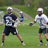 West Newbury: Pentucket freshman Kyle Richardson (13) defends his stepbrother, Triton's Paul Dacy (29) during Tuesday afternoon's lacrosse game in West Newbury. Photo by Ben Laing/Staff Photo