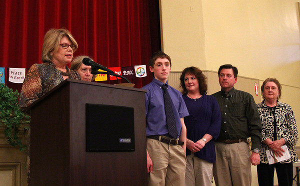 Newburyport: Principal Mary Reardon of the Immaculate Conception school, left, awards student Liam Rogers, with a Peace Prize Monday night at Newburyport City Hall. The prizes were handed out by the Commission for Diversity and Tolerance, and included 12 students from the Newburyport schools, and 2 adults. Photo by Ben Laing/Staff Photo