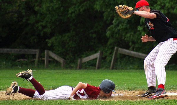 Newburyport: Colby Morris (9) of Newburyport slides back to first base on a pick off attempt during Tuesday afternoon's game against Amesbury at the lower field. Photo by Ben Laing/Staff Photo