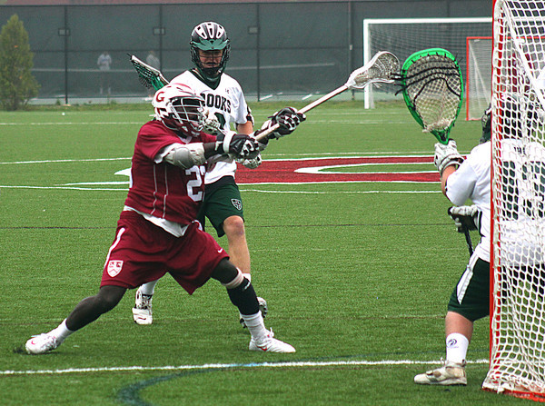 Byfield: AJ Enchill (23) of Governors Academy scores early in Monday's lacrosse game against visiting Brook Academy. Photo by Ben Laing/Staff Photo