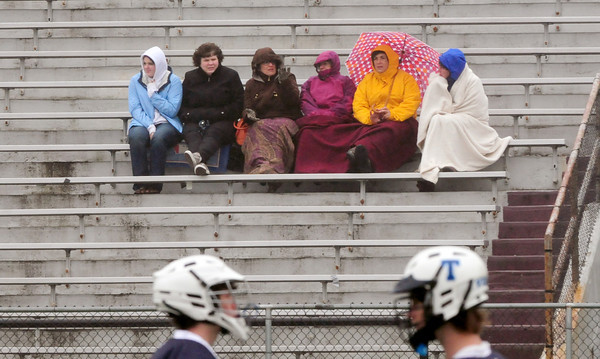 Newburyport: Spectators to the lacrosse game between Triton at Newburyport were bundled up against the cool drizzle yesterday afternoon. The sun may peek through the clouds for a bit on Friday and Saturday. Bryan Eaton/Staff Photo