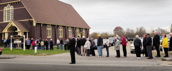 Salisbury: A long line of mourners waited to pay their respects to Father Thomas B. Morgan as he lay in state at the Star of the Sea Beach Chapel yesterday afternoon. His body was removed later to the main chapel on Beach Road for another viewing at night. The popular priest, who recently retired after 34 years at the church, died at home Friday in his hometown of Salem. Bryan Eaton/Staff Photo