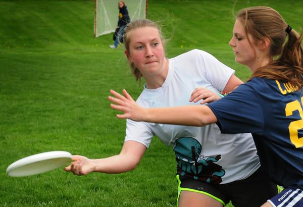 Newburyport: Newburyport's Julia Chatfield looks for an open teammate as an Andover player puts on the pressure. Bryan Eaton/Staff Photo