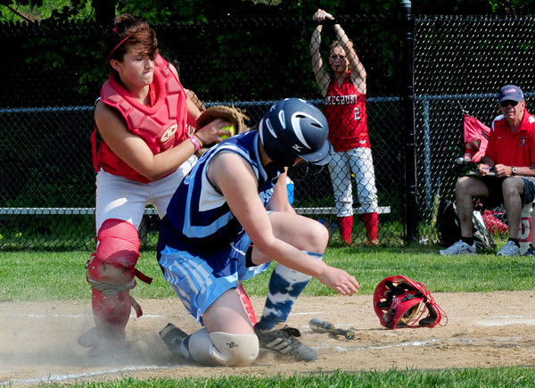 Amesbury: Amesbury catcher Laura Kaminski gets Triton's Emily Jutras out at home plate. Bryan Eaton/Staff Photo