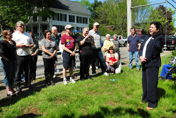 Newburyport: Newburyport Mayor Donna Holaday speaks to a gathering of about 25 people at a rededication of a plaque honoring the Break-o-Day Hills Boys who volunteered in World War II, the men being from the neighborhood around Plummer Avenue at Merrimac Street. The original plaque was disintegrating and volunteer fundraising has allowed a new metal plaque to be installed in its place. The plaque is on the property of Barbara Merritt and her family, who are related to some of the men who served along with most of the attendees. Bryan Eaton/Staff Photo