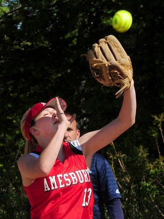 Amesbury: Eyes squinting in the sunlight, Amesbury first baseman Erin Leary catches a Wilmington pop up. Bryan Eaton/Staff Photo
