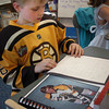 Salisbury: Cael Kohan, 7, reads off his presentation of hockey legend Bobby Orr at Salisbury Elementary School. Second-graders researched famous people from the past made presentations of them to parents at their Living Museum. Bryan Eaton/Staff Photo