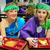 Seabrook: Hailey Gettman, left, and Hannah White, both 13, are wearing their Greek garb while at lunch at Seabrook Elementary School after participating in Olympic games. After lunch they then feasted on a buffet at the end of their unit on Ancient Greek culture.  Bryan Eaton/Staff Photo