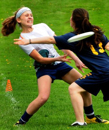 Newburyport: Newburyport's Elena Robidoux sends the frisbee past a defending Andover player at the Nock Middle School. Bryan Eaton/Staff Photo