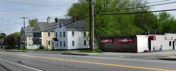 Amesbury: The old Whistling Kettle, right, would be demolished to make was for a proposed CVS store on Route 110 in Amesbury, and likely some houses to the left, though it's hoped at least one can be moved. Bryan Eaton/Staff Photo